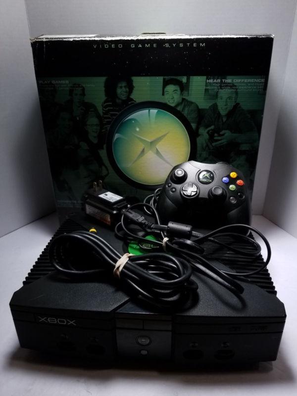 Modded OG Xbox has XBMC, NES , SNES , N64 , Sega, PS1